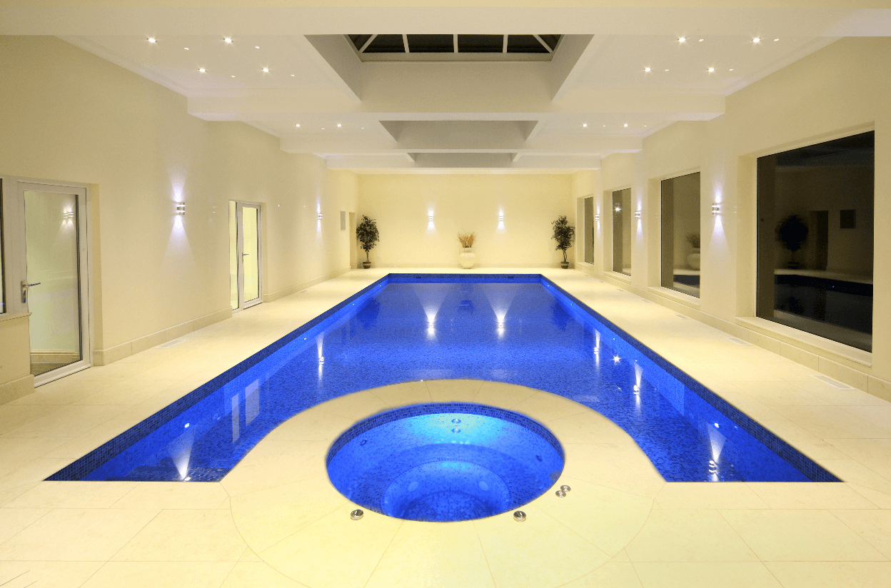 Cream Indoor Swimming pool with a round hot tub