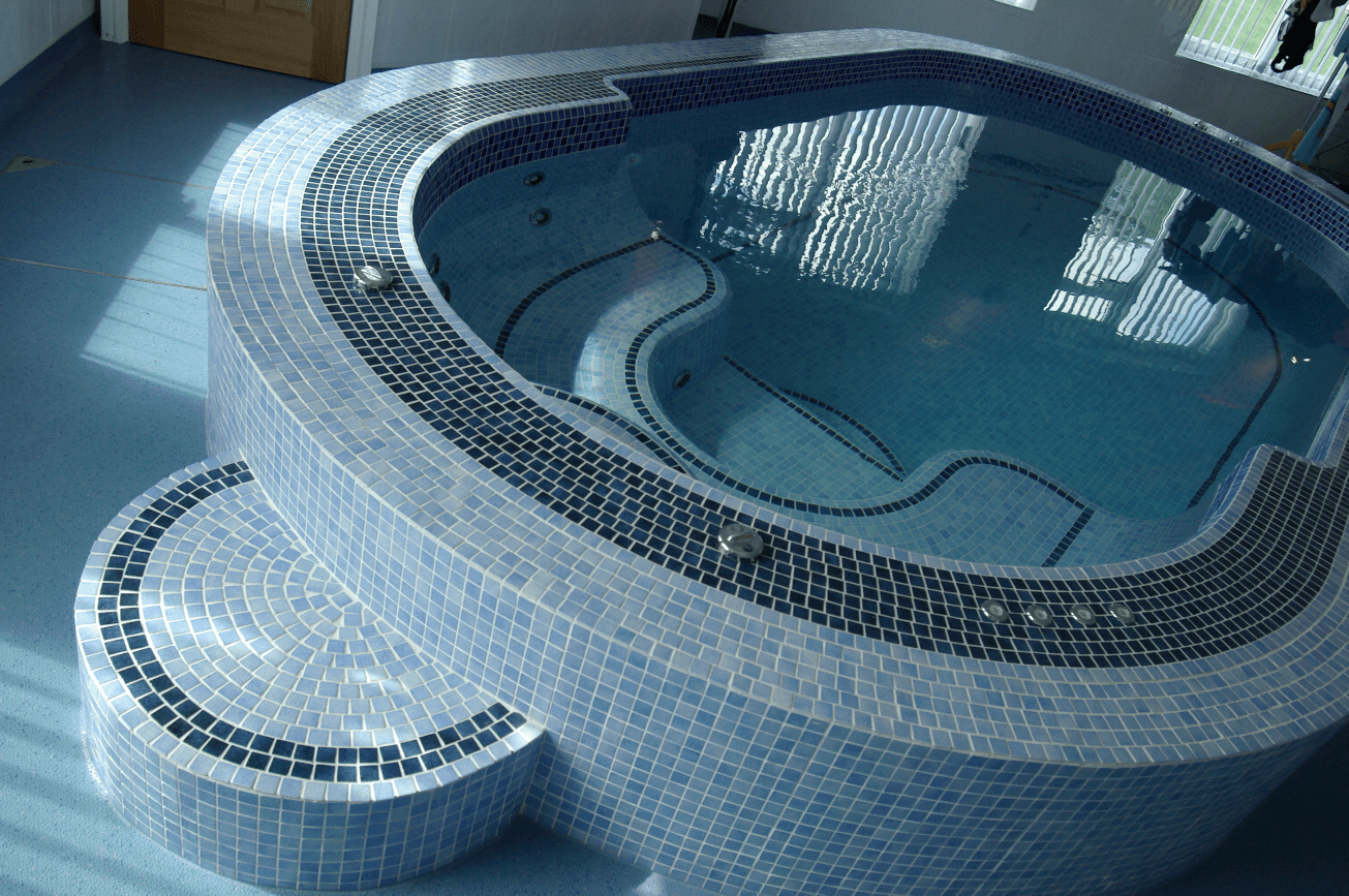 A blue tiled swim spa